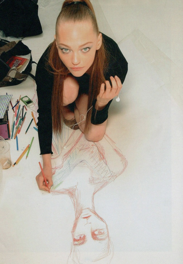 Sasha Pivovarova drawing a self-portrait backstage at Matthew Williamson